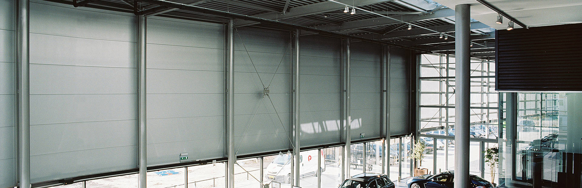 Qbiss One prefabricated architectural wall on Porsche car showroom